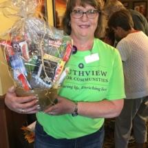 Alzheimers Fundraiser-Oak Park Senior Living-silent auction winner with prize