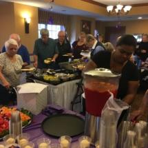 Alzheimers Fundraiser-Oak Park Senior Living-people digging in