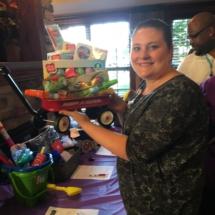 Alzheimers Fundraiser-Oak Park Senior Living-showing off silent auction basket