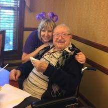 Alzheimer's Fundraiser-Villas of Oak Park Senior Living-staff member hugging one of the tenants