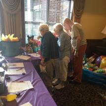 Alzheimer's Fundraiser-Villas of Oak Park Senior Living-Oak Park tenants checking out silent auction