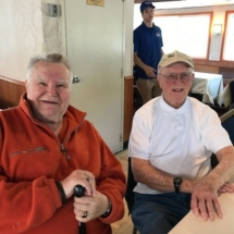 Stillwater Boat Ride-Villas of Oak Park-men smiling for the camera